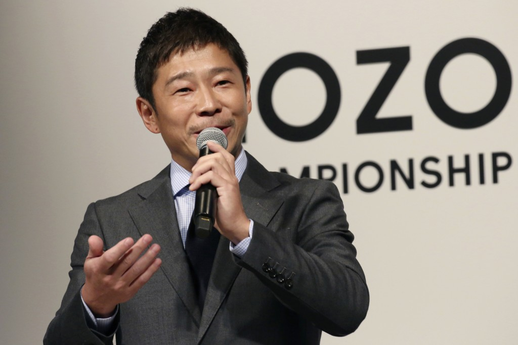 FILE - In this Nov. 20, 2018, file photo, Zozo Chief Executive Yusaku Maezawa speaks during a press conference on the PGA Tour in Tokyo. Yahoo Japan C...