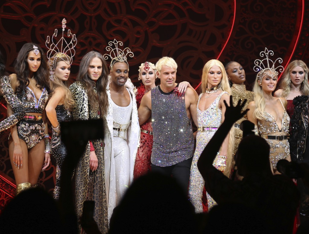 This Sept. 9, 2019 photo shows, foreground from third left, Jordan Roth, Billy Porter, The Blonds designers David Blond and Phillipe Blond and Paris H