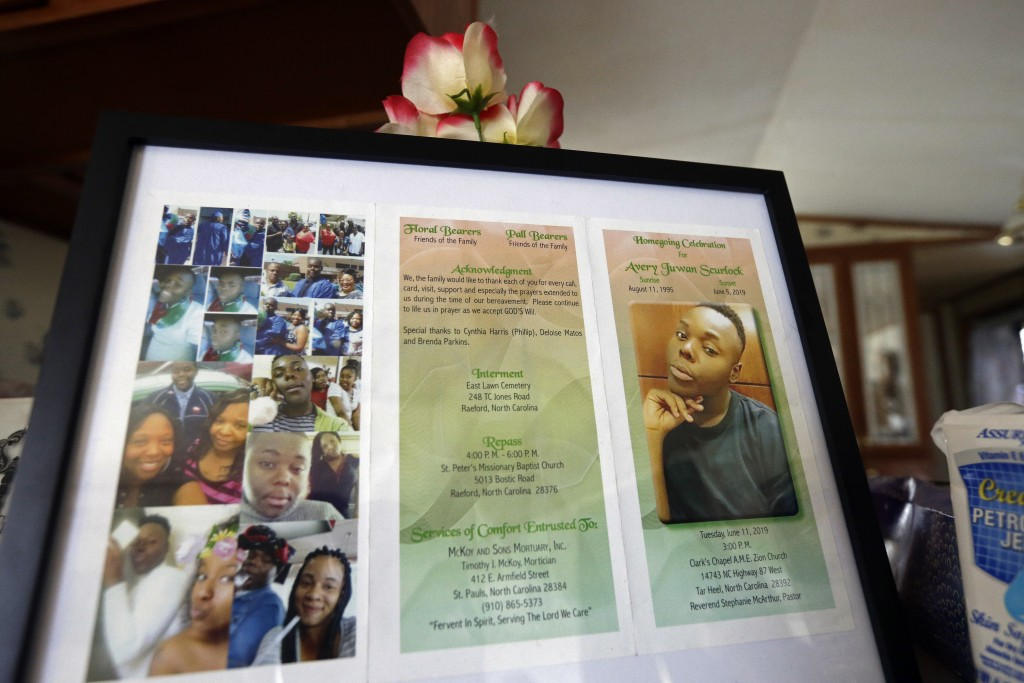 In this photo taken Tuesday, Aug. 6, 2019, a framed copy of Avery Scurlock's memorial is shown in Avery's mother Brenda Scurlock's home in Lumber Brid