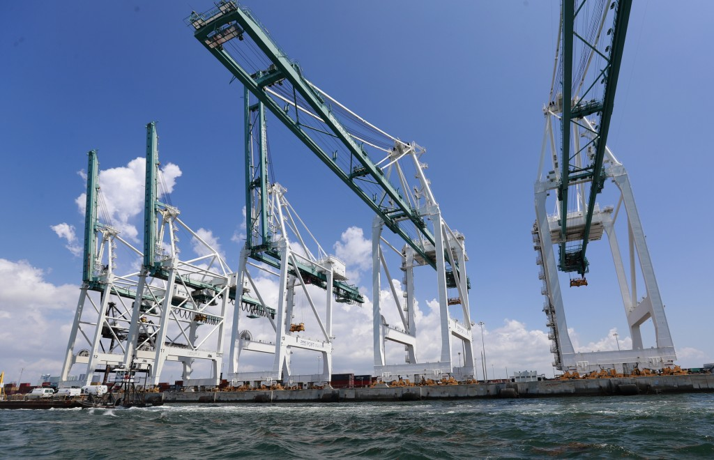 FILE - In this July 24, 2019 photo, file large cranes to unload container ships are shown at PortMiami in Miami. The Trump administration is seeking t