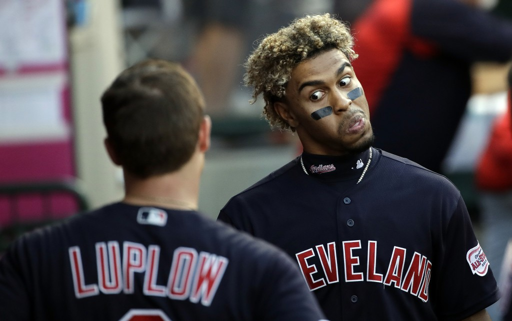 Cleveland Indians' Francisco Lindor, right, jokes in the dugout with Jordan Luplow during the team's baseball game against the Los Angeles Angels on W...