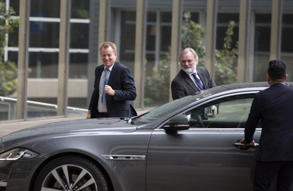 United Kingdom's Brexit advisor David Frost, left, and British Ambassador to the EU Tim Barrow, center, arrive at EU headquarters for a technical meet
