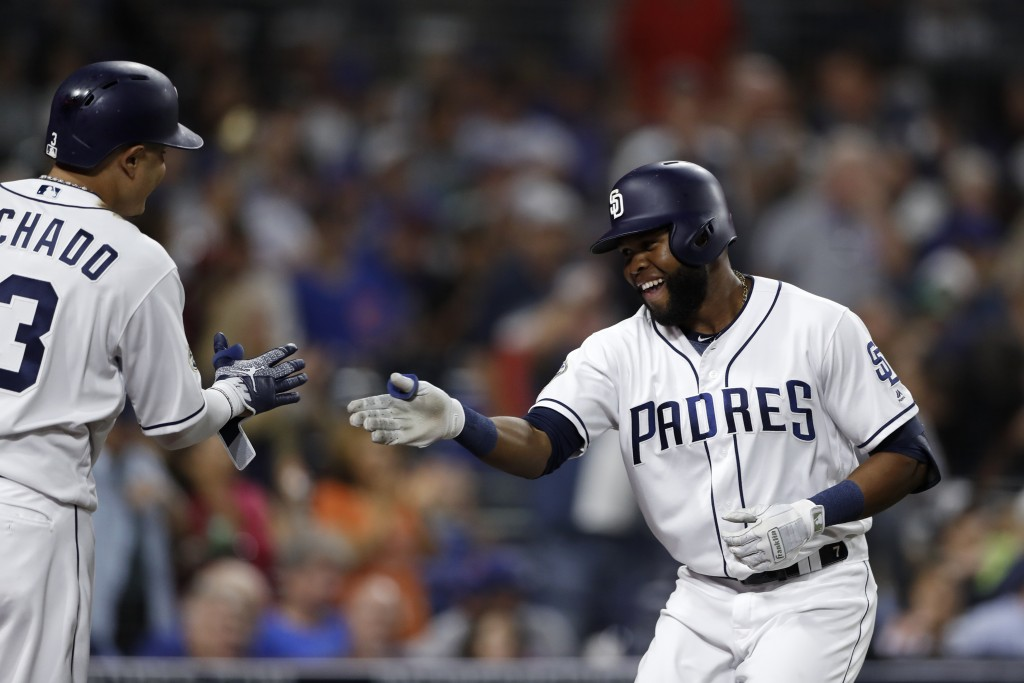 San Diego Padres' Manuel Margot, right, is greeted by teammate Manny Machado after hitting a home run during the fifth inning of a baseball game again...