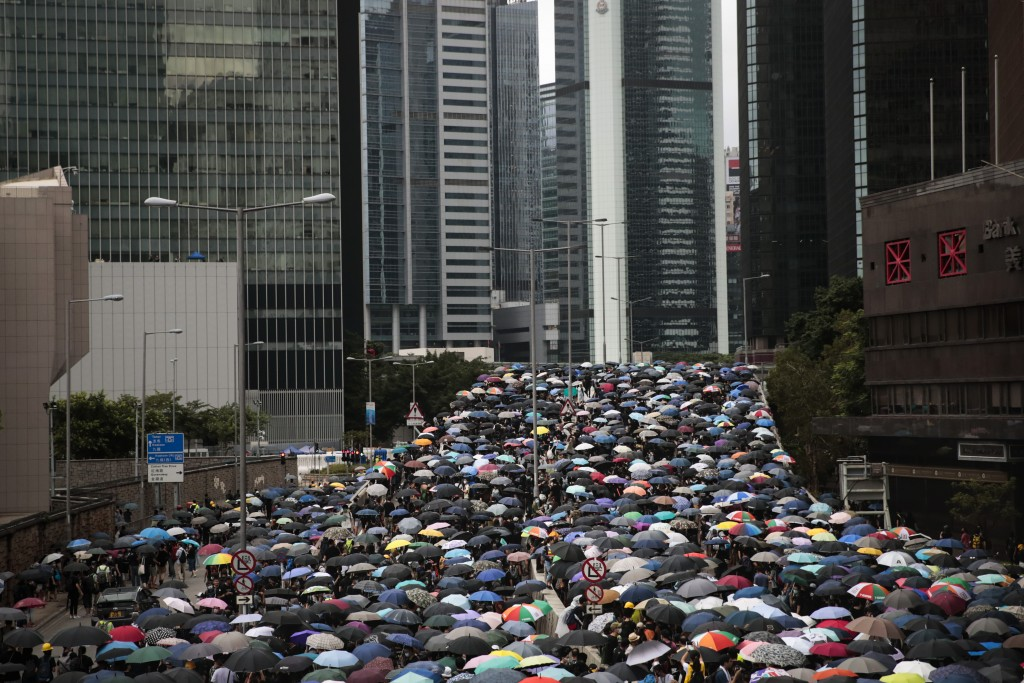 In this Saturday, Aug. 31, 2019 photo, Pro-democracy protesters march in central Hong Kong. Life is not quite normal after three months of steady prot...