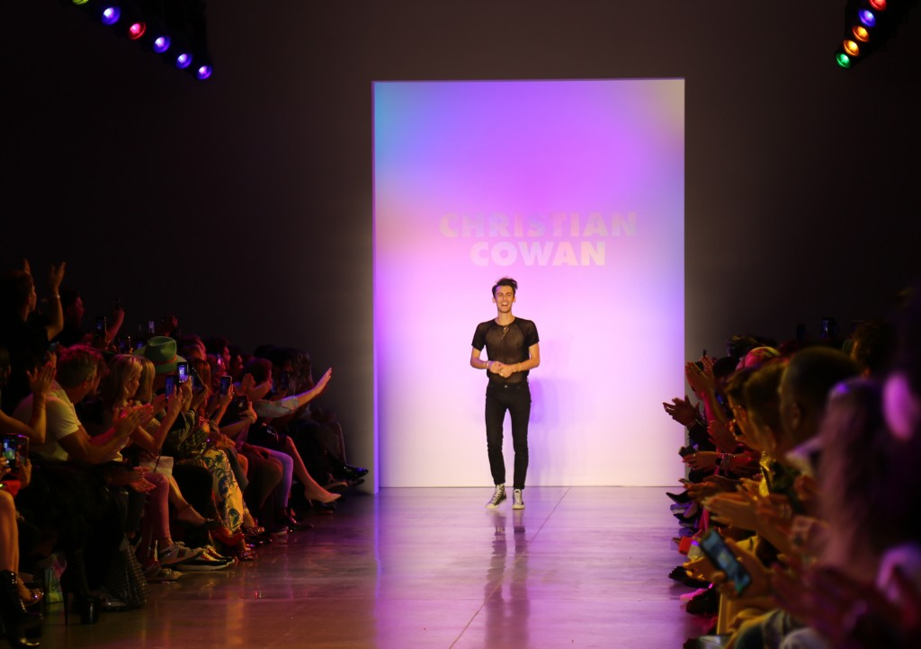 Christian Cowan acknowledges the audience applause after his collection was shown during Fashion Week in New York on Tuesday, Sept. 10, 2019. (AP Phot...