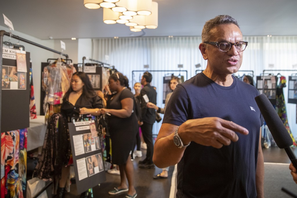 Designer Naeem Khan gives an interview backstage before his collection is modeled during Fashion Week, Tuesday, Sept. 10, 2019, in New York. (AP Photo