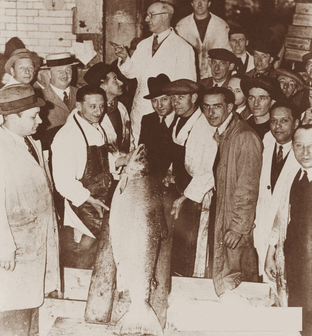 In this 1934 photo provided by H. Forman & Son, Louis Forman, center, Lance Forman's grandfather poses with the large wild salmon caught at that time,