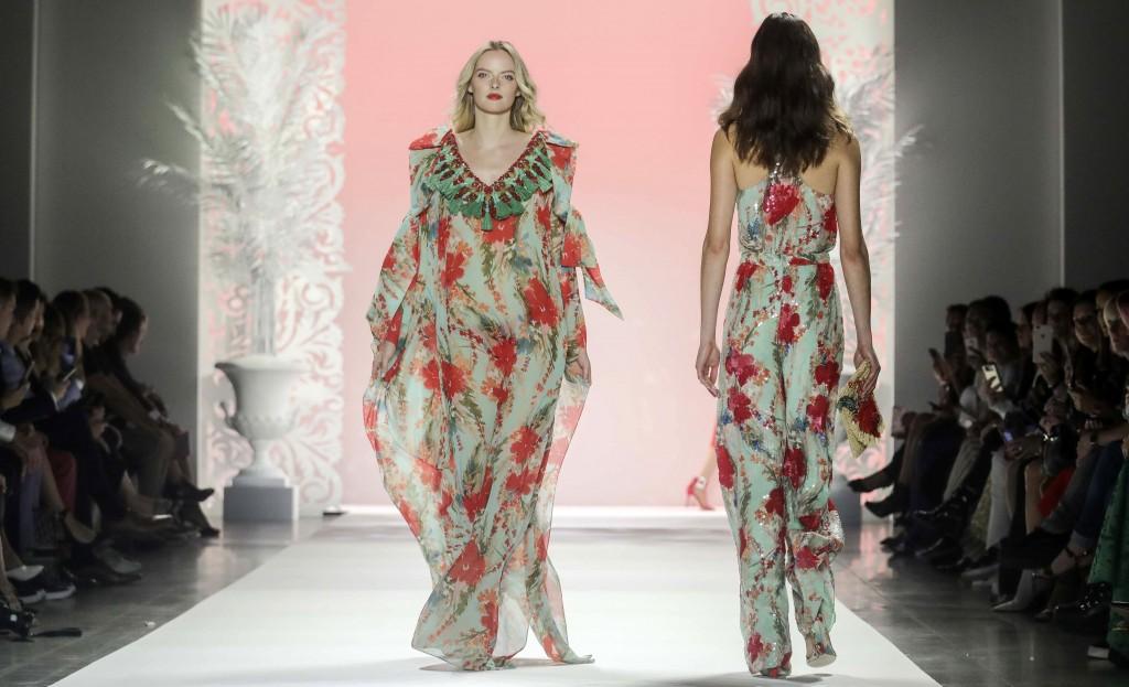 The latest fashion creation from Badgley Mischka is modeled during New York's Fashion Week, Wednesday Sept. 11, 2019. (AP Photo/Bebeto Matthews)