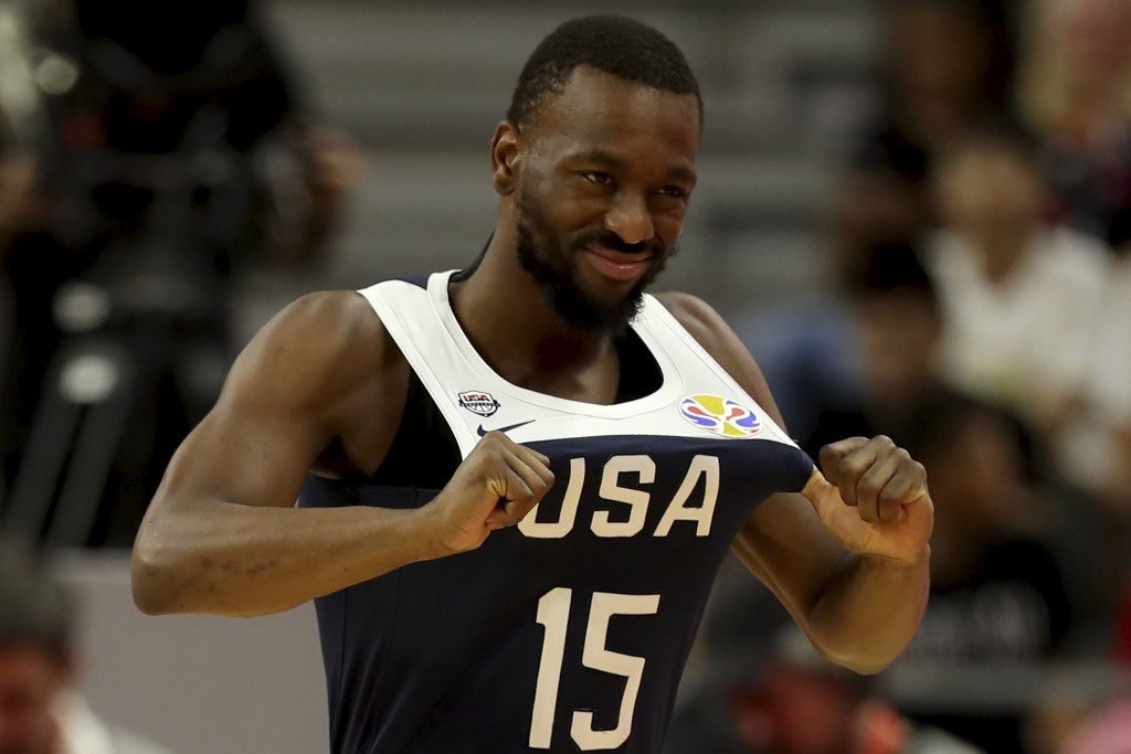 United States' Kemba Walker pulls on his jersey during a consolation playoff game against Serbia for the FIBA Basketball World Cup in Dongguan in sout...