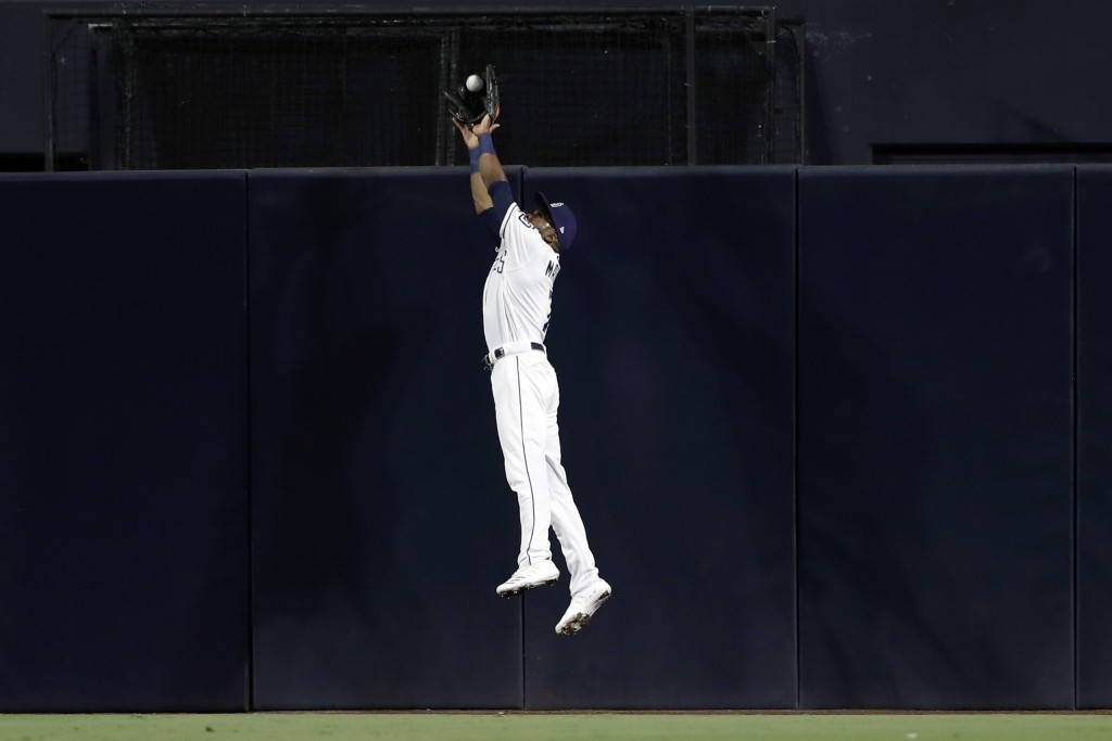 San Diego Padres center fielder Manuel Margot makes the catch above the wall for the out on Chicago Cubs' Nicholas Castellanos during the fourth innin...
