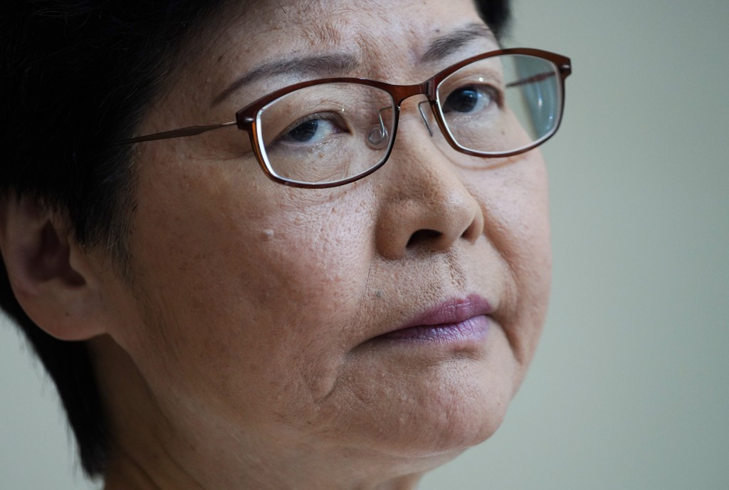 Hong Kong Chief Executive Carrie Lam, listens to reporters questions during a press conference at the government building in Hong Kong Tuesday, Sept. ...