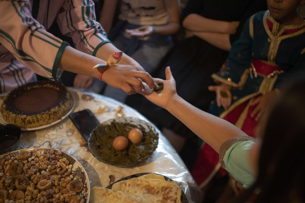 In this Tuesday, Sept. 10, 2019 photo, a young girl gets a henna tattoo to celebrate the occasion of Ashura, in Sale, near Rabat, Morocco. On Sept. 9,...