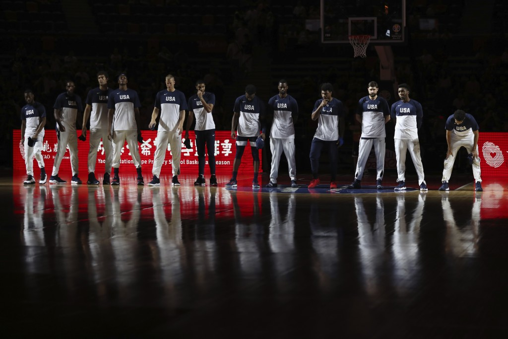 United States players line up for a consolation playoff game against Serbia for the FIBA Basketball World Cup in Dongguan in southern China's Guangdon...