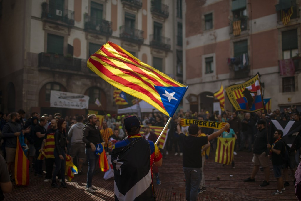 Protesters hold independence flags during the Catalan National Day in Barcelona, Spain, Wednesday, Sept. 11, 2019. The traditional September 11, calle...