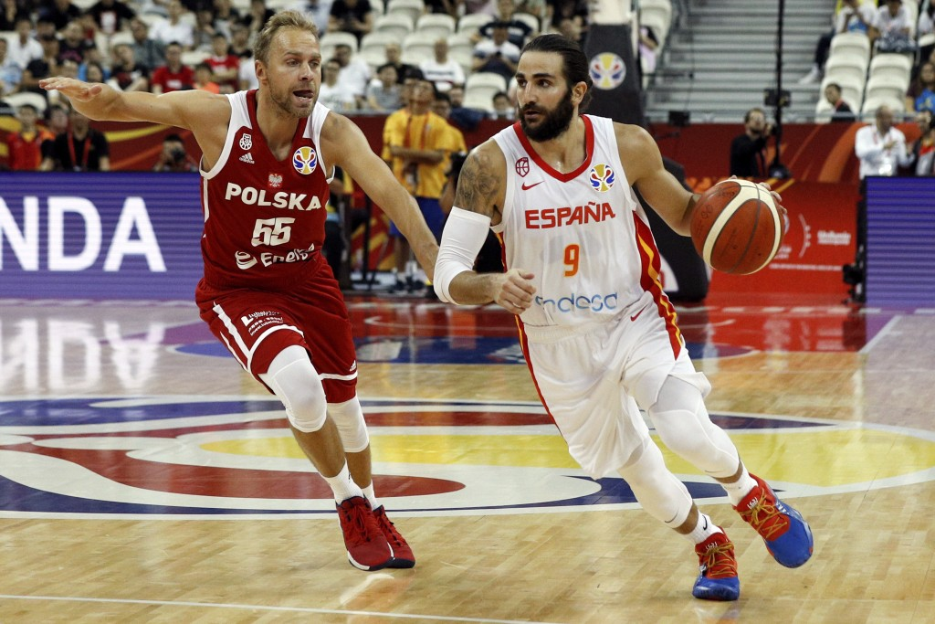Ricky Rubio of Spain controls the ball over Lukasz Koszarek of Poland during their quarterfinals match for the FIBA Basketball World Cup, at the Shang