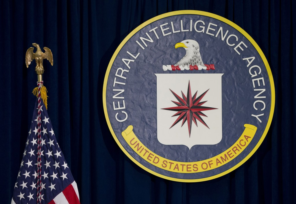 FILE - This April 13, 2016 file photo shows the seal of the Central Intelligence Agency at CIA headquarters in Langley, Va. Most stories about espiona