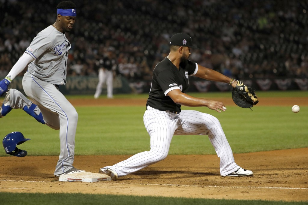 Kansas City Royals' Jorge Soler, left, reaches first as Chicago White Sox first baseman Jose Abreu is unable to handle a throw from third baseman Yoan