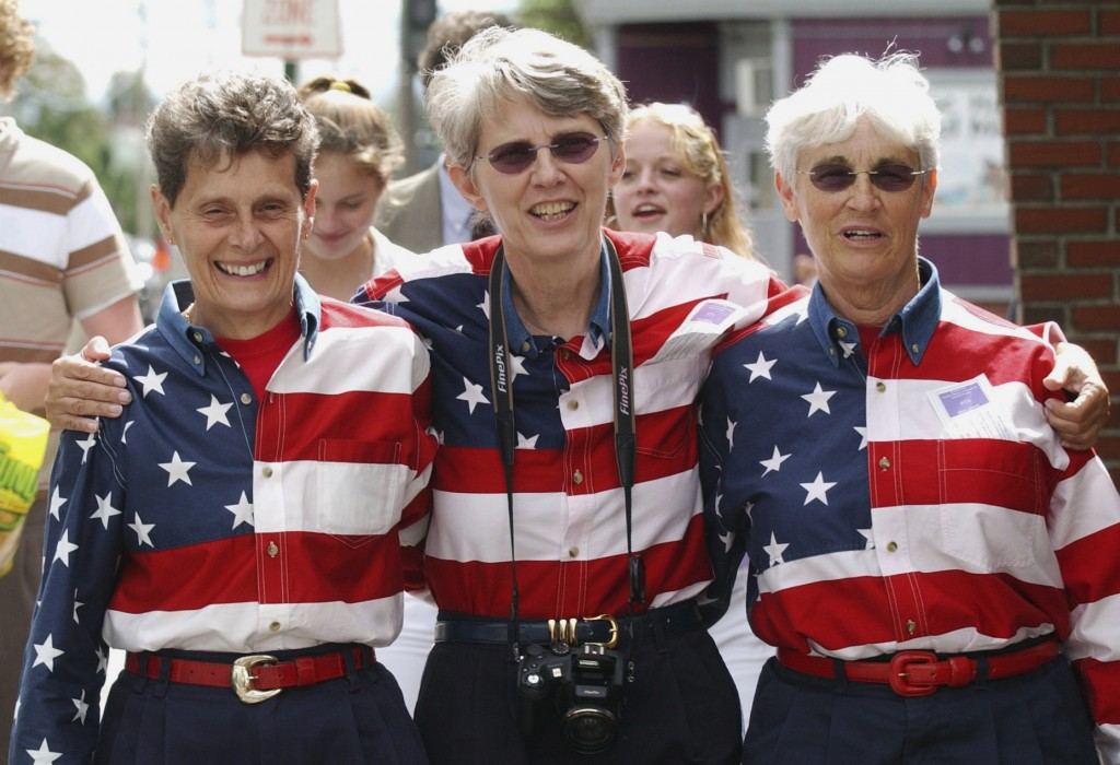 """FILE - In this Sept. 10, 2004, file photo, The """"Freeport Flag Ladies"""" leave a campaign rally for President Bush in Lewiston, Maine. From left are Carm"""