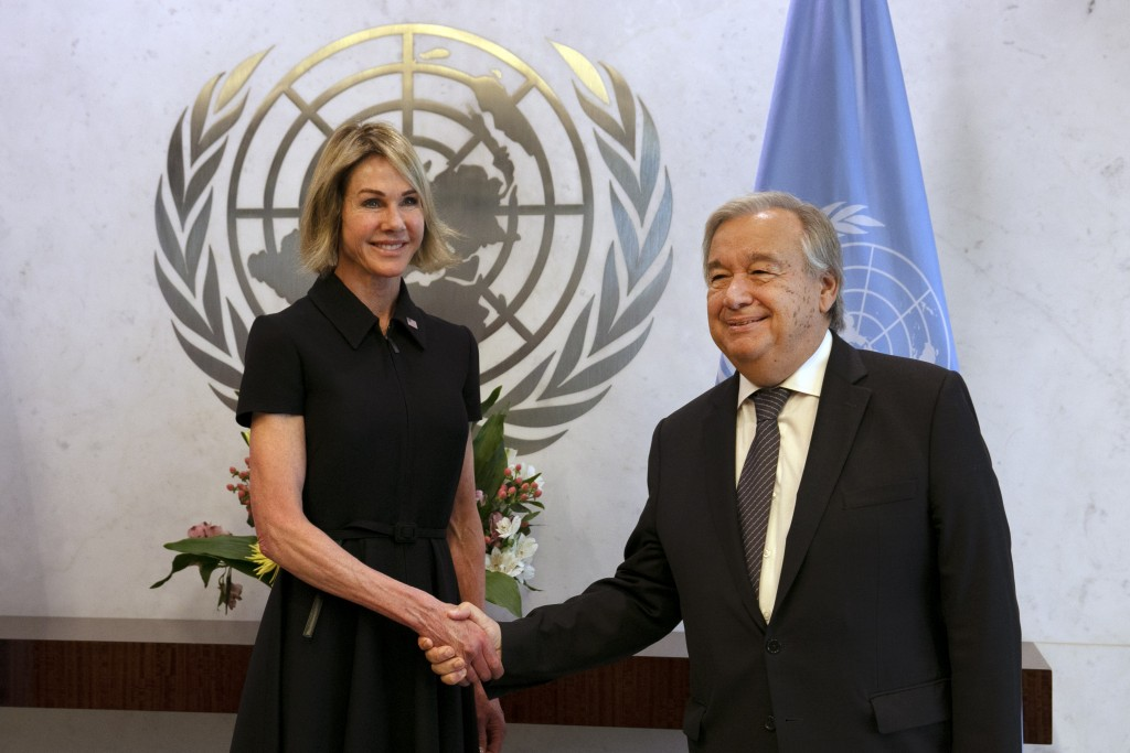 New U.S. Ambassador Kelly Craft shakes hands UN Secretary General Antonio Guterres after she presented her cresentials at United Nations headquarters,...
