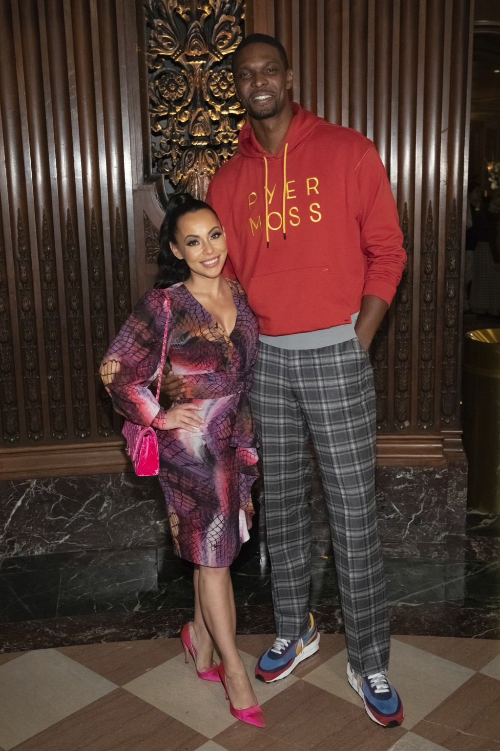 Professional basketball player Chris Bosh and a guest attend the Pyer Moss runway show during NYFW Spring/Summer 2020 on Sunday, Sept. 8, 2019, in Bro...
