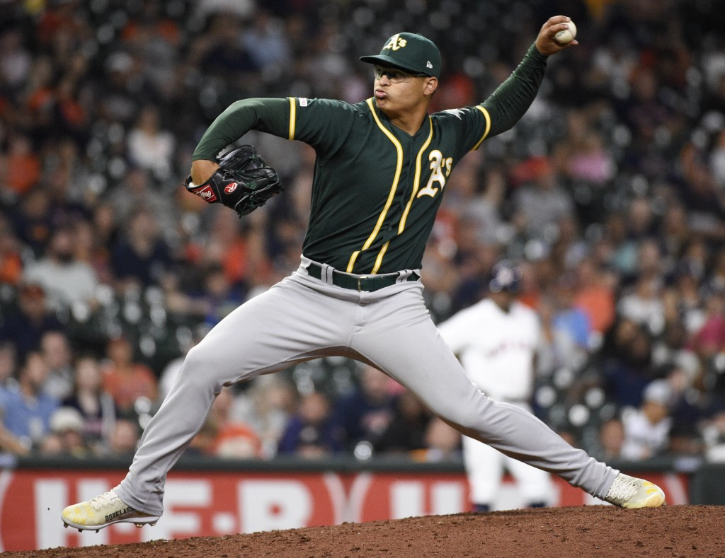 Oakland Athletics relief pitcher Jesus Luzardo delivers during the sixth inning of a baseball game against the Houston Astros, Wednesday, Sept. 11, 20...