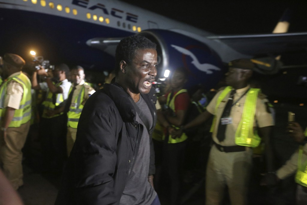 A Nigerian returnee from South Africa due to recently violence targeted at foreigners reacts upon arrival at the Murtala Muhammed International Airpor
