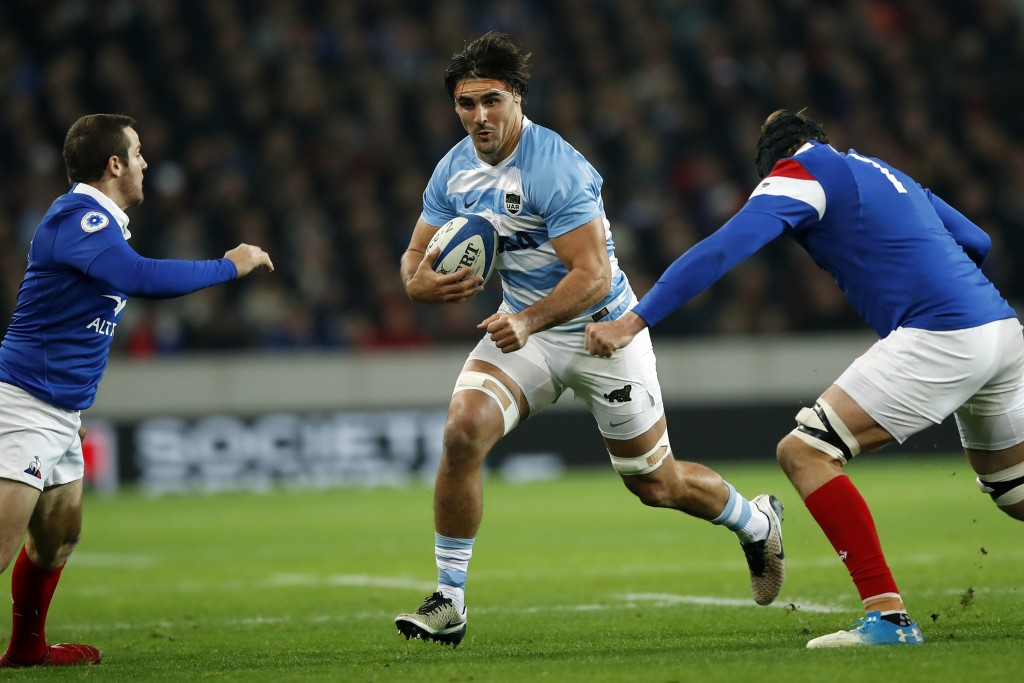 FILE - In this Nov. 17, 2018, file photo, Argentina's Pablo Matera, center, tries to pass between France's Camille Lopez, left, and France's Arthur It