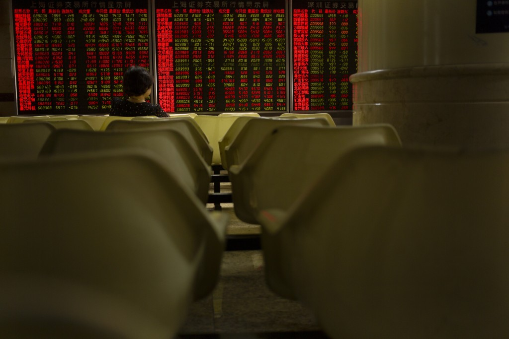 A Chinese investor monitors stock prices at a brokerage house in Beijing, Wednesday, Sept. 11, 2019. Asian shares were mostly higher Wednesday, cheere