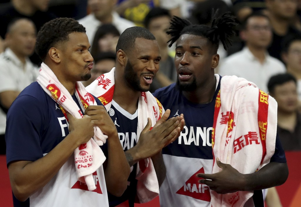 French players react as they near a win over United States during a quarterfinal match for the FIBA Basketball World Cup in Dongguan in southern China...