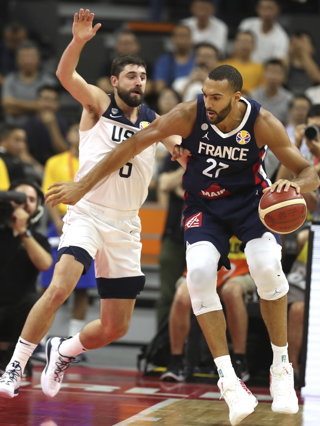 United States' Joe Harris tries to stop France's Rudy Gobert during a quarterfinal match for the FIBA Basketball World Cup in Dongguan in southern Chi...