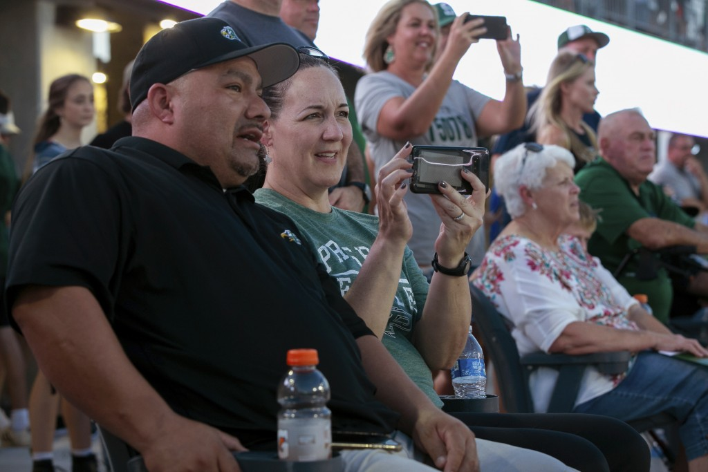Lisa DeMarco and Rey Martinez watch students on the field during the opening of the new Children's Health Stadium at Prosper ISD on Saturday, Aug. 17,