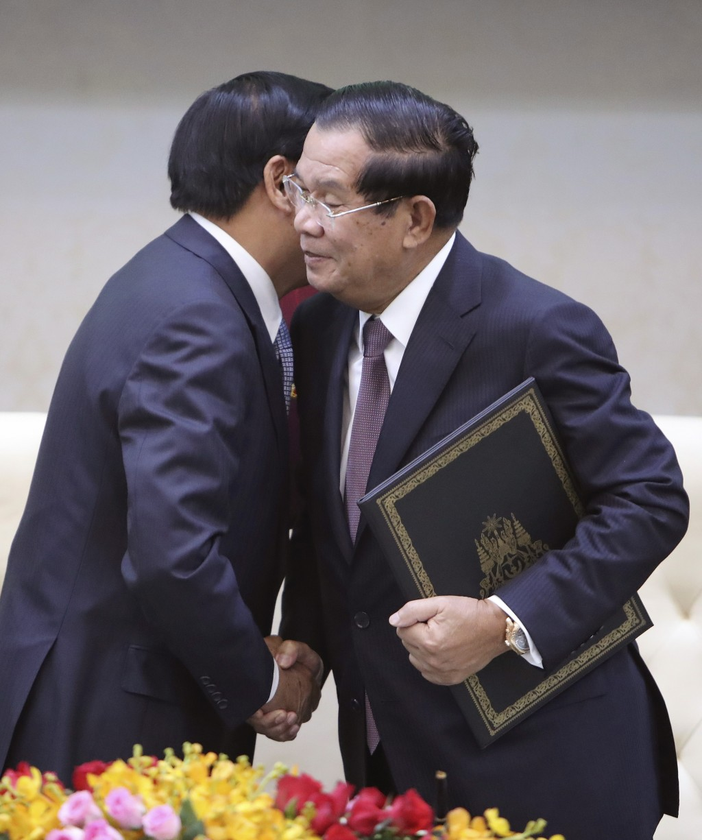 Cambodian Prime Minister Hun Sen, right, hugs his Laos counterpart Thonloun Sisoulith during a signing ceremony, in Phnom Penh, Cambodia, Thursday, Se...