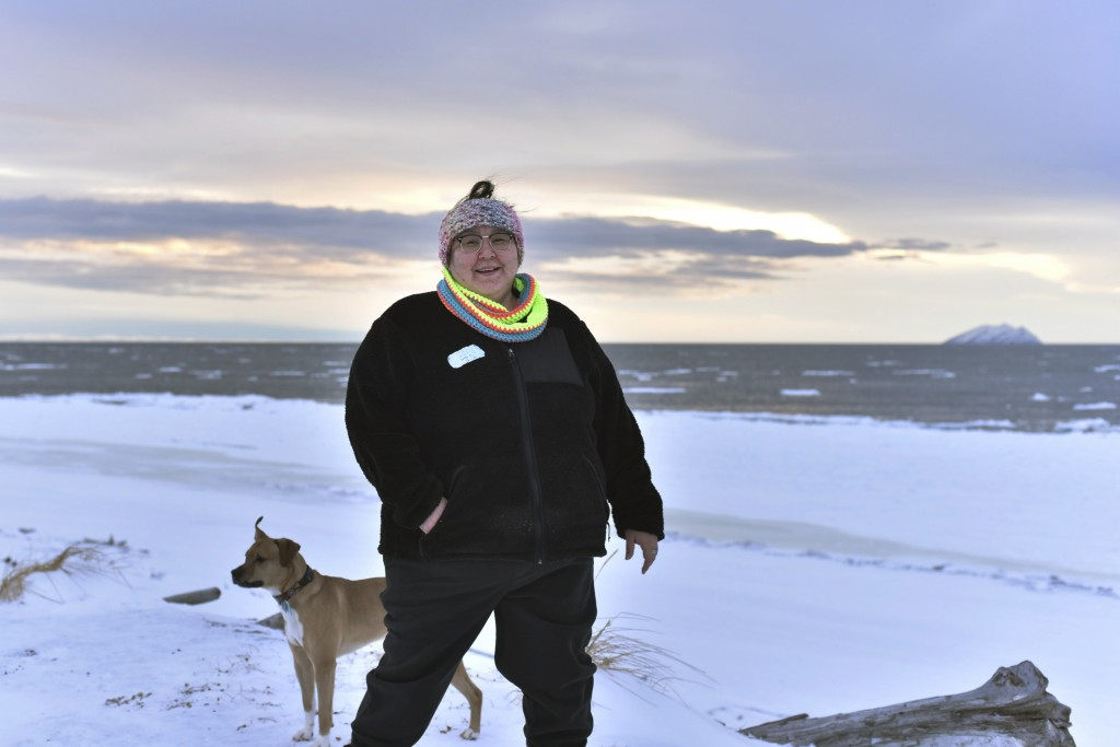 "In this Jan. 14, 2019 photo, Clarice ""Bun"" Hardy stands on the beach with her dog, Marley, in the Native Village of Shaktoolik, Alaska. Hardy, a forme..."