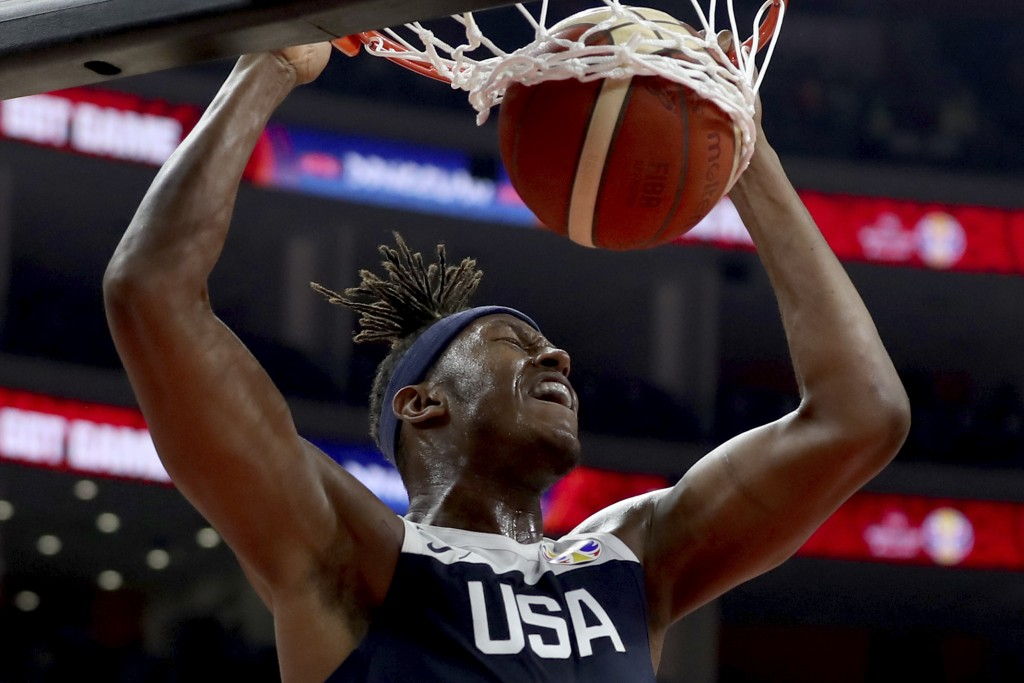 United States' Myles Turner dunks during a consolation playoff game against Serbia for the FIBA Basketball World Cup in Dongguan in southern China's G