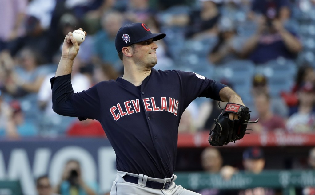 Cleveland Indians starting pitcher Adam Plutko throws to a Los Angeles Angels batter during the first inning of a baseball game Wednesday, Sept. 11, 2...
