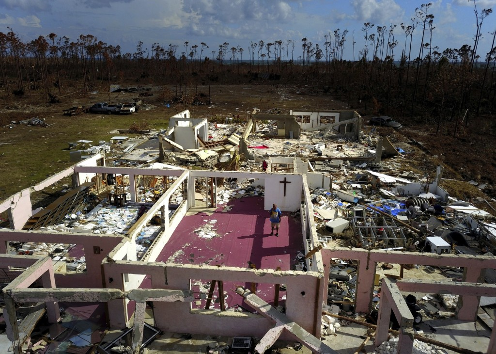Pastor Jeremiah Saunders poses for a photo among the ruins of his church that was destroyed by Hurricane Dorian, in High Rock, Grand Bahama, Bahamas, ...