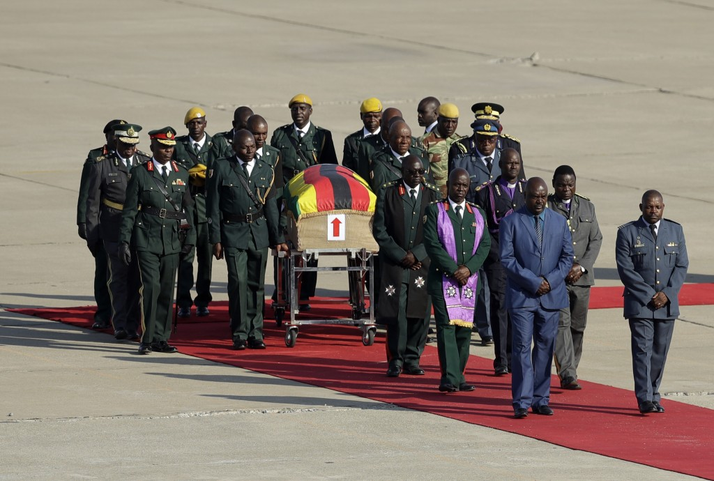 A coffin carrying the remains of Zimbabwe's longtime ruler Robert Mugabe arrives from Singapore, at Robert Gabriel Mugabe International Airport in Har