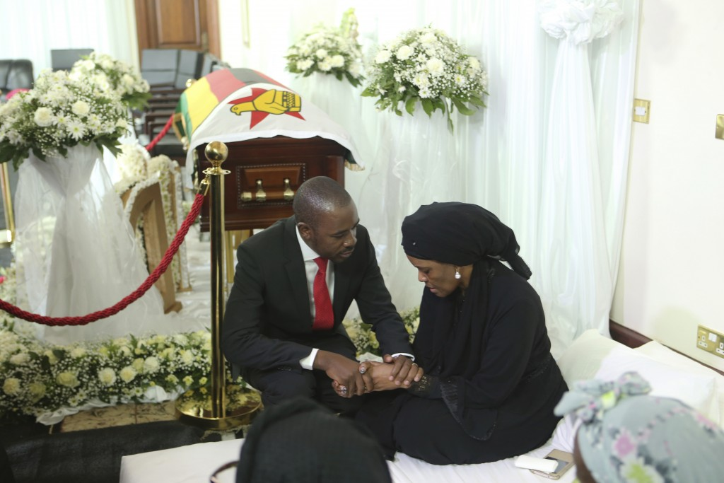 Nelson Chamisa, left, leader of the main opposition party in Zimbabwe, consoles Grace, wife to former Zimbabwean leader Robert Mugabe at his residence