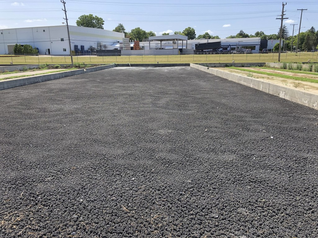 This July 31, 2019 photo shows sewage sludge from the Lapeer Wastewater Treatment Plant in drying beds, where it is being stored until an arrangement