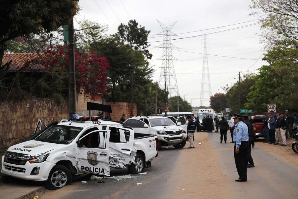 Police inspect the area near the bullet ridden vehicles after jailed drug lord Jorge Teofilo Samudio Gonzalez escaped from custody, in Asuncion, Parag...