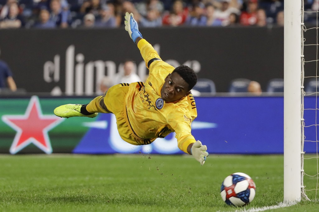 New York City FC goalkeeper Sean Johnson dives for a ball shot on goal during the second half of an MLS soccer match against Toronto FC Wednesday, Sep...