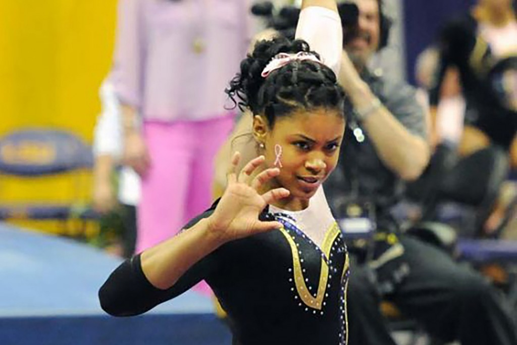 In this March 8, 2013, photo provided by LSU Student Media, LSU senior Britney Taylor finishes her floor routine at a gymnastics event in Baton Rouge,
