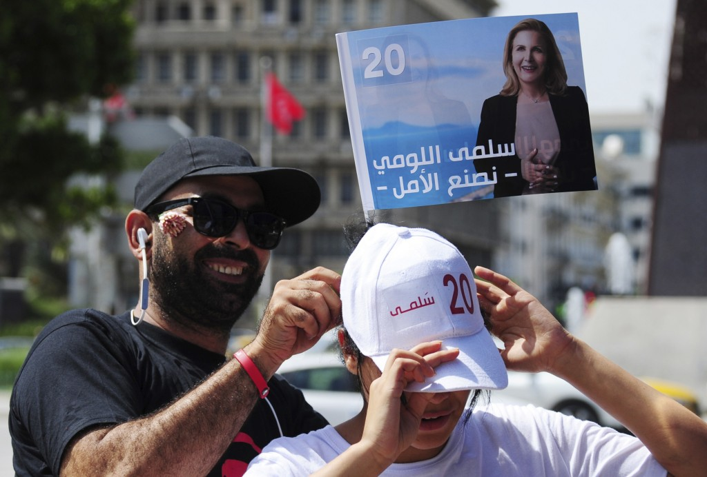 A supporter of Tunisian presidential candidate Sel...