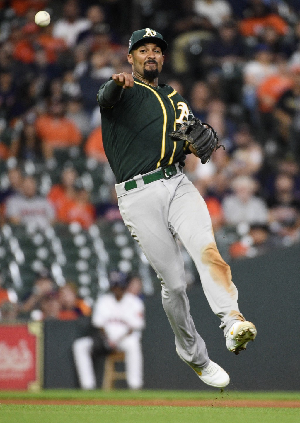 Oakland Athletics shortstop Marcus Semien throws out Houston Astros' George Springer during the seventh inning of a baseball game Wednesday, Sept. 11,