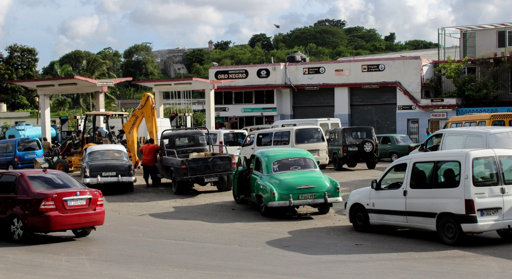 People line up with their vehicles to load up on fuel at a gas station in Havana, Cuba,Wednesday, Sept. 11, 2019.The island nations is facing a diesel