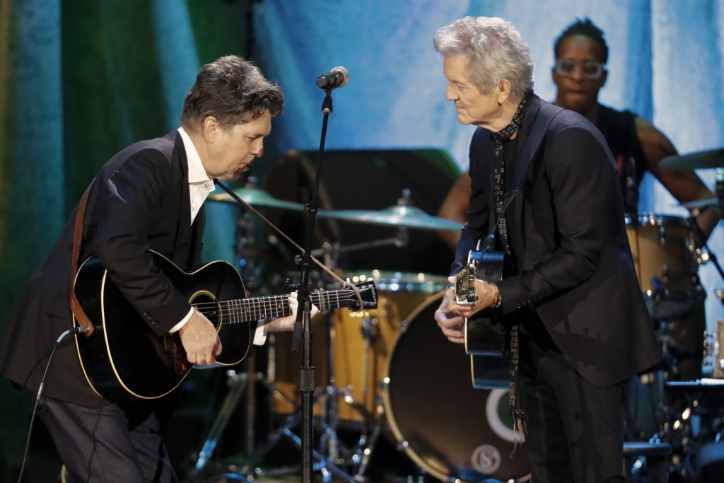 Joe Henry, left, and Rodney Crowell perform during the Americana Honors & Awards show Wednesday, Sept. 11, 2019, in Nashville, Tenn. (AP Photo/Wade Pa