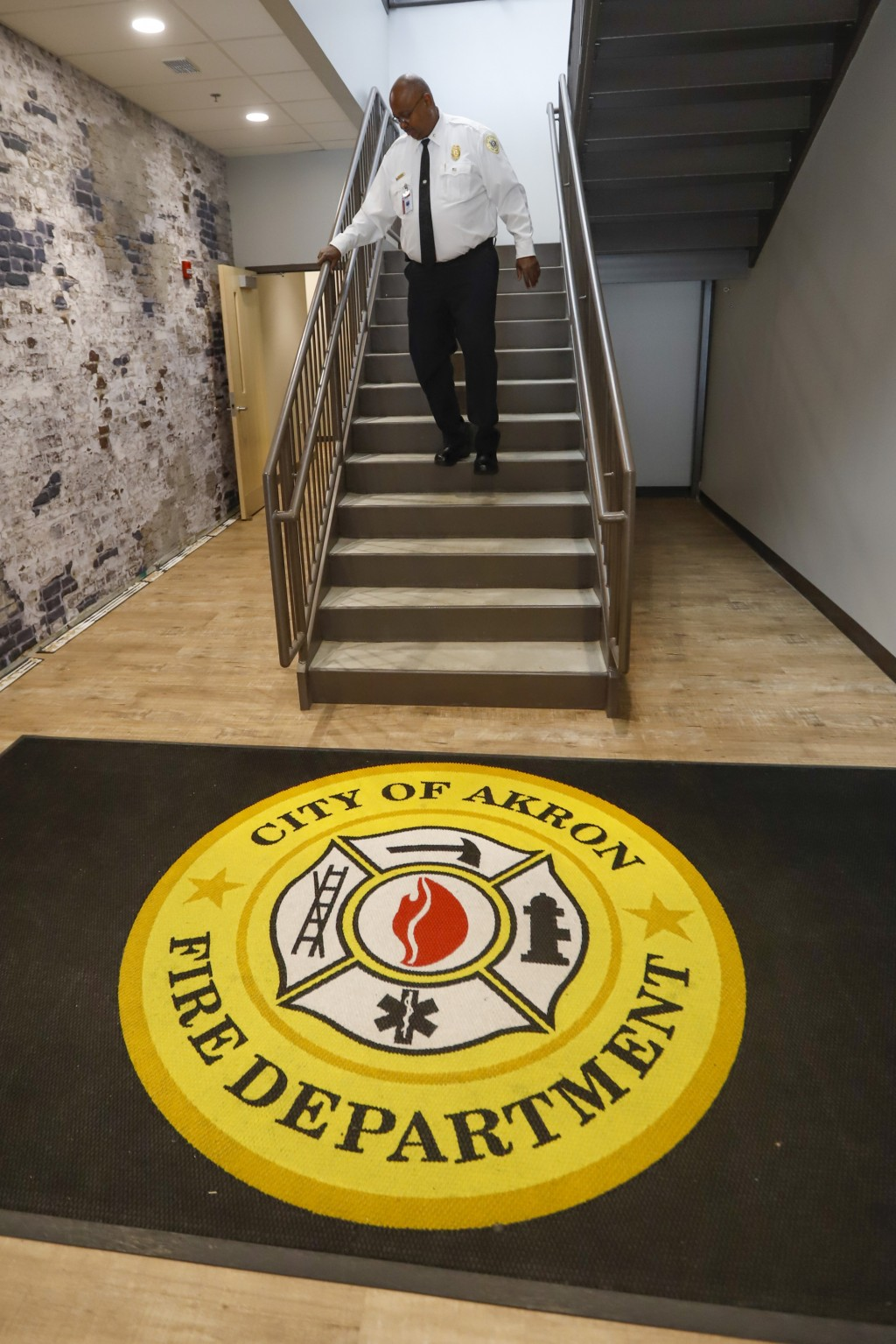"""In this Sept. 11, 2019, photo, Akron Fire Chief Clarence Tucker comes down the stairs at Fire Station No. 4, in Akron, Ohio. """"You can get a call someo"""