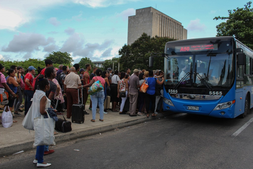 Locals line up to board a public service bus in Havana, Cuba, Wednesday, Sept. 11, 2019. The island nations is facing a diesel fuel shortage but the g