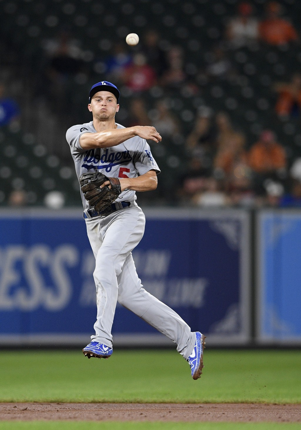 Los Angeles Dodgers shortstop Corey Seager throws to first to get out Baltimore Orioles' Dwight Smith Jr. during the fourth inning of a baseball game ...