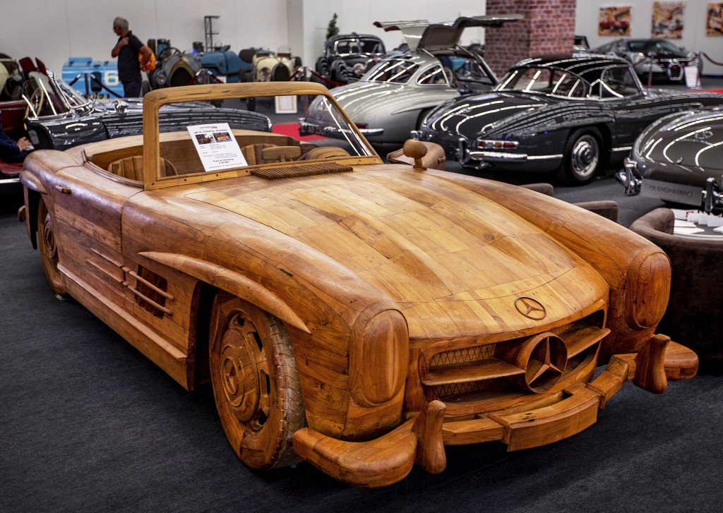 A Mercedes 300 SL Gullwing Roadster made of Teak wood is displayed at the IAA Auto Show in Frankfurt, Germany, Wednesday, Sept. 11, 2019. (AP Photo/Mi...